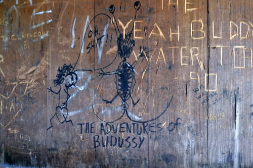 Graffiti in a lean-to shelter.
